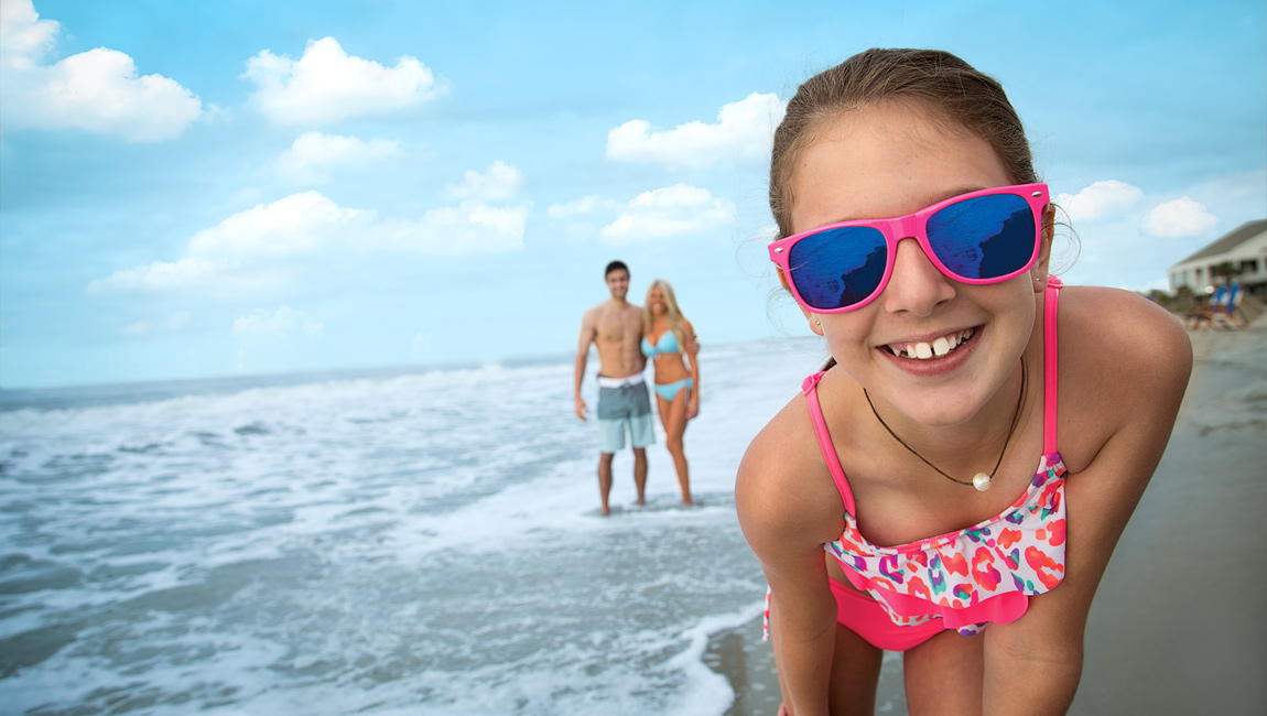 Girl wearing sunglasses at the beach