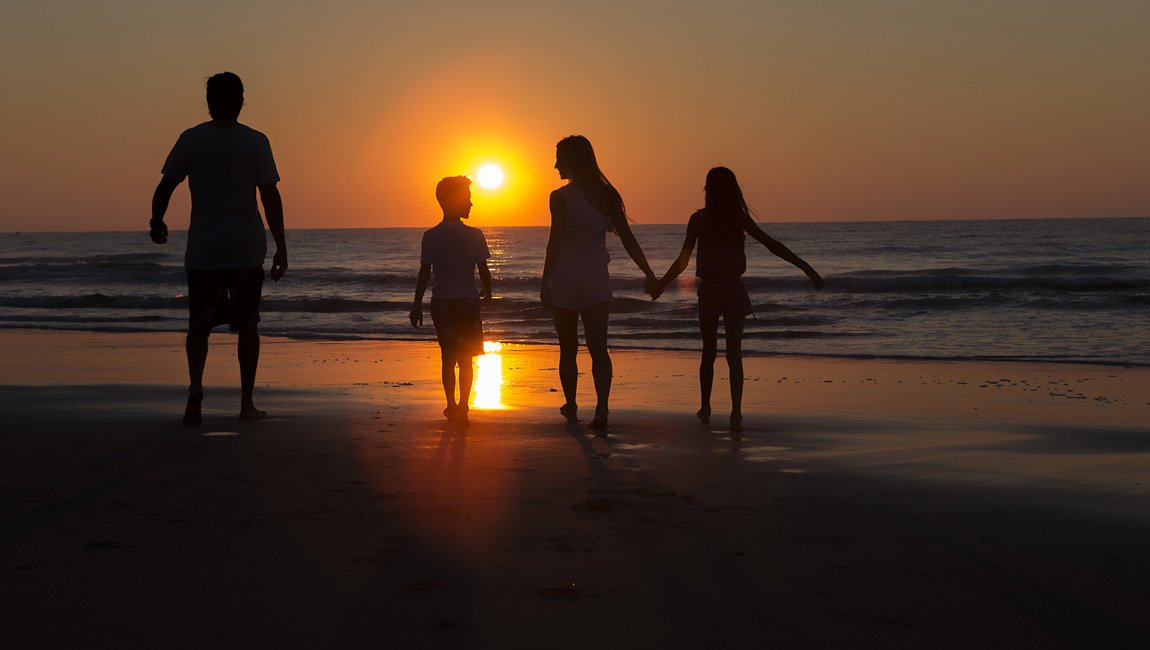 Family in Myrtle Beach at sunrise
