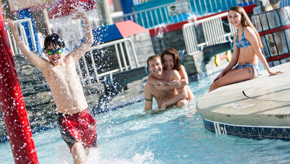 Family enjoying the Shipwreck Kids' Waterpark