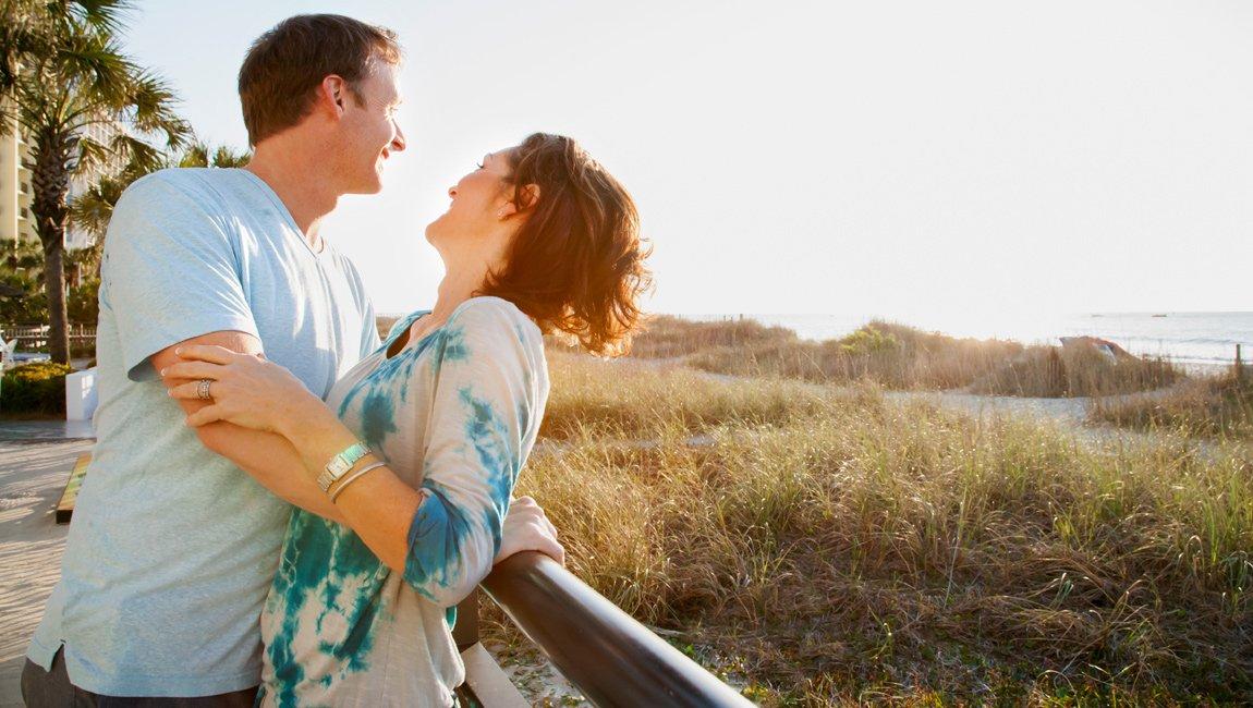 Beachfront couple at oceanfront resort