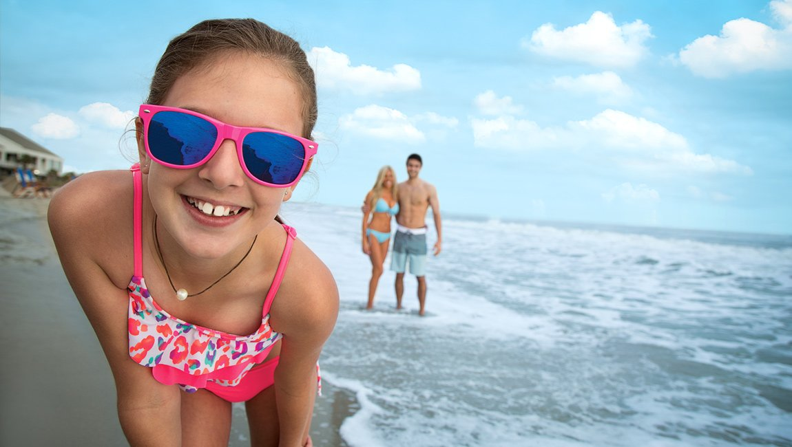 Girl wearing sunglasses on the beach